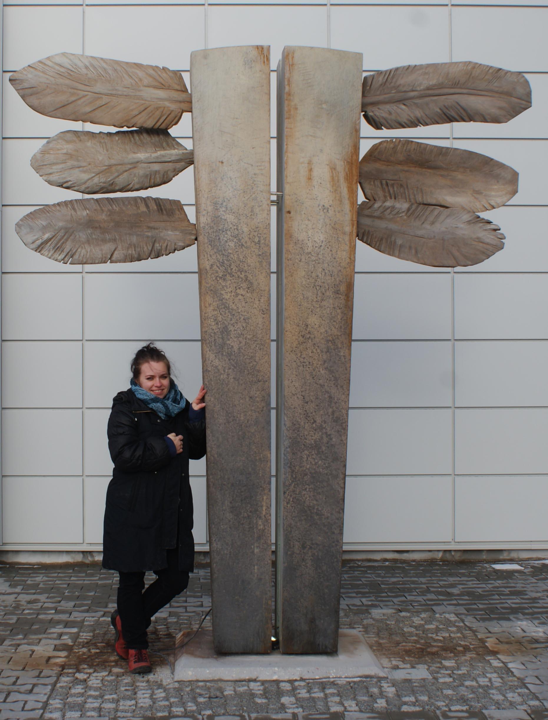 Adriana Majdzińska with his sculpture, ICARUS- wood, light, 2013, Koscierzyna, Poland